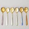 A set of twelve 1950s/60s enamelled and gilt silver coffee spoons, tillander, helsinki.