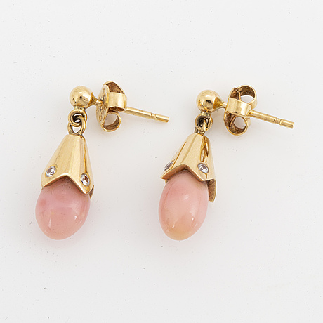 A pair of natural conchpearl and diamond earrings.