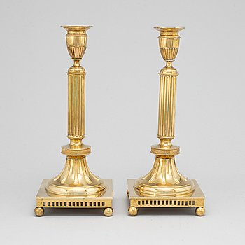 A pair of Skultuna brass candlesticks, No 71, early 20th Century.