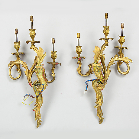 A pair of rococo style bronze wall lights, ca 1900.
