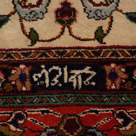 A carpet, old täbriz, ca 382 x 293 cm.
