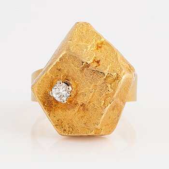 969. A 14K gold ring set with a round brillant-cut diamonds, made by a part of a Lapponia bracelet.
