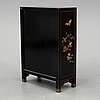 A chinese black lacquered cabinet, 20th century.