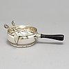 A georg jensen 'magnolia' sterling silver sugar tongs and a brandypan, denmark 1934.