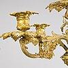 A pair of 19th-century brass candelabra, presumably france.