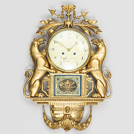 A swedish empire wall clock by g undén (stockholm 1800-1829).