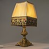 A gilt-bronze and brass table lamp with red glass, presumably from france/italy, late 19th and early 20th century.