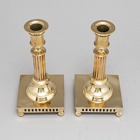 A pair of brass candlesticks, grillby, no 92, 20th century.