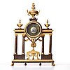 A late gustavian porphyry imitation and gilt wooden mantel clock by wilhelm pauli (clockmaker in stockholm 1795-1809).