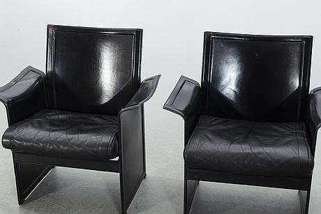 "Tito agnoli, a pair of chairs, ""korium"", matteo grassi, second half of 20th century."