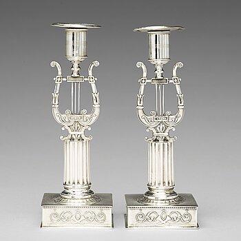 199. A pair of Swedish 19th century silver cadlesticks, mark of Johan Petter Grönvall, Stockholm 1823.