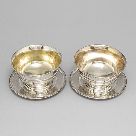 A pair of swedish 19th century parcel-gilt silver sauce bowls, mark of jp gronvall, stockholm 1821.