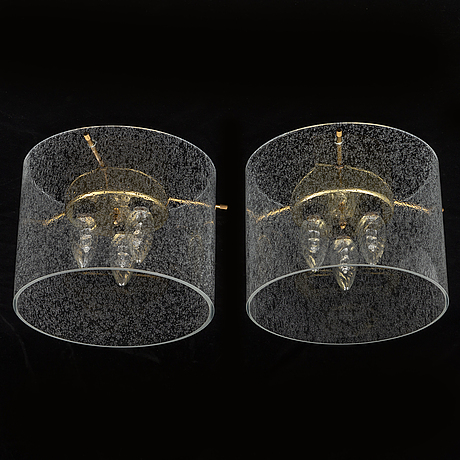 A pair of late 20th century ceiling light by kjell munch.
