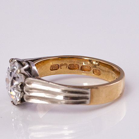 An 18k gold ring with an ca 3.19 ct old cut diamond by westerlund n. & co, helsinki 1961.