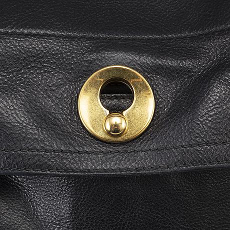 Yves saint laurent, a black leather 'muse' bag.