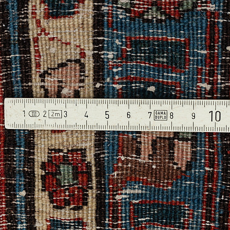 A semi-antique veramin 337 x 224 cm.
