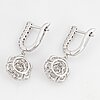 Brilliant-cut diamond flower earrings.