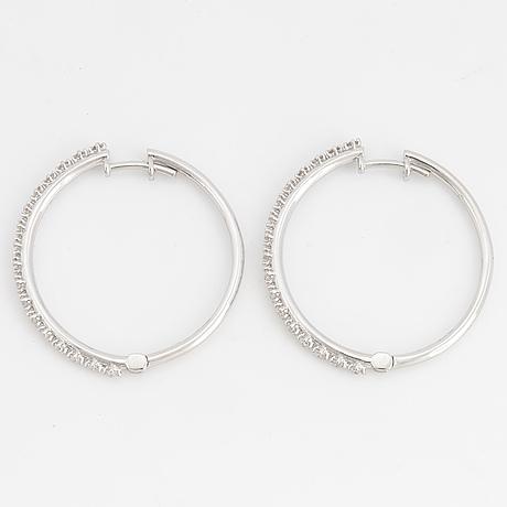 Brilliant-cut diamond hoop earrings.