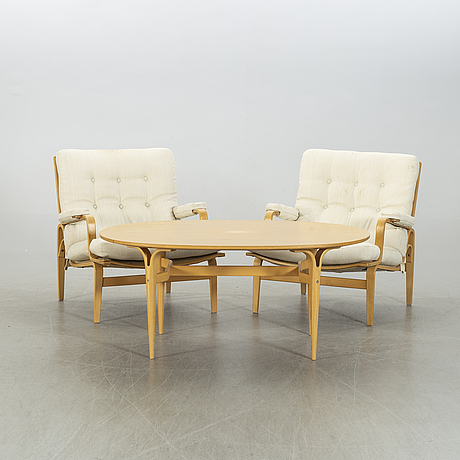 "Bruno mathsson, a pair of ""ingrid"" arm chairs, coffe table, dux, end of 20th century."