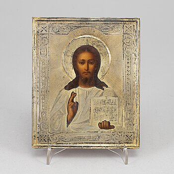 A Russian silver-gilt icon, unidentified makers mark, Moscow 1889.