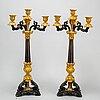 A pair of mid 19th century bronze candelabra.