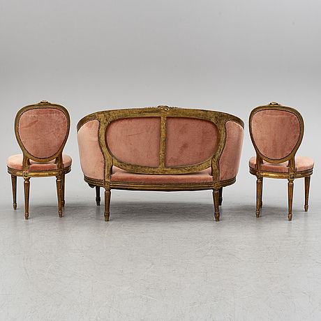 A sofa and a pair of chairs, louis xvi-style, late 19th century.