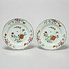 A famille rose serving dish and two plates, qing dynasty, qianlong (1736-95).