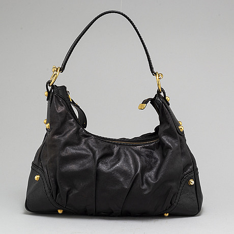 Gucci, a black leather bag.