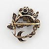 Silver and gold diamond brooch.