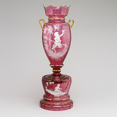 A ca 1900 glass vase on a base.