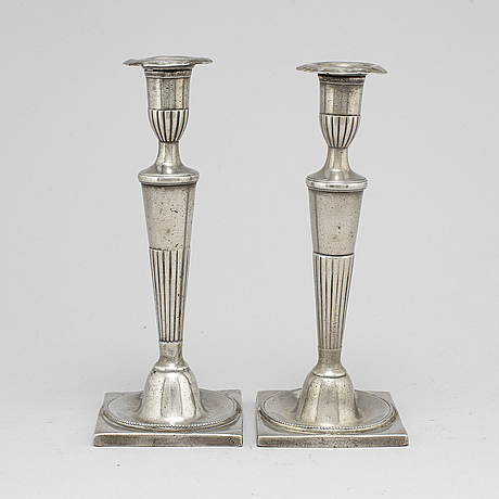 A pair of late 18th century pewter candlesticks.