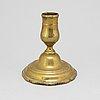 An 18th century candlestick.