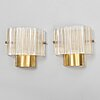 Carl fagerlund, a pair of brass and glass wall lights from orrefors.