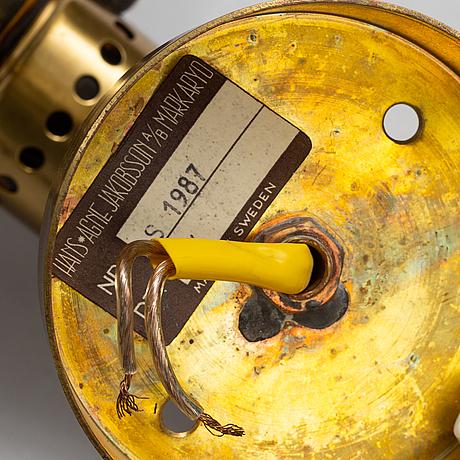 Hans-agne jakobsson, a brass and glass wall light from markaryd.