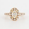 18k rose gold and 1 oval diamond and round brilliant-cut diamonds.