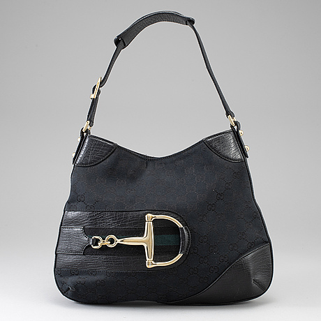 Gucci, a black canvas and leather bag.