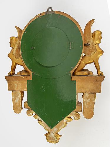 An empire-stuyle wall clock, circa 1900.