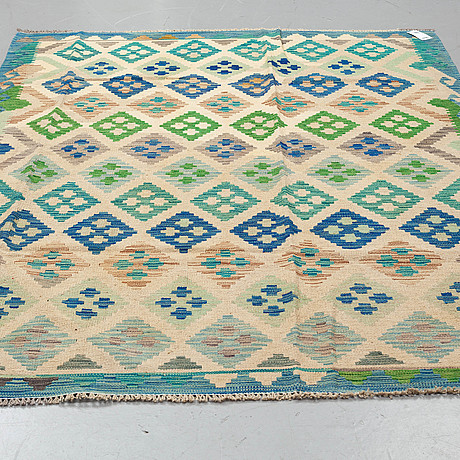 A rug, kilim, ca 240 x 171 cm.