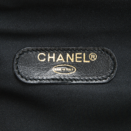 Chanel, black quilted garment cover bag.