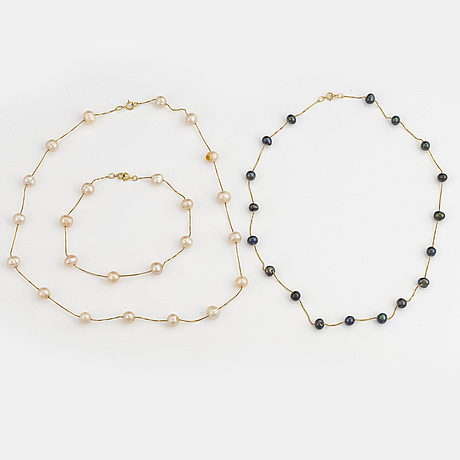 Two cultured pearl necklaces and cultured pearl bracelet.