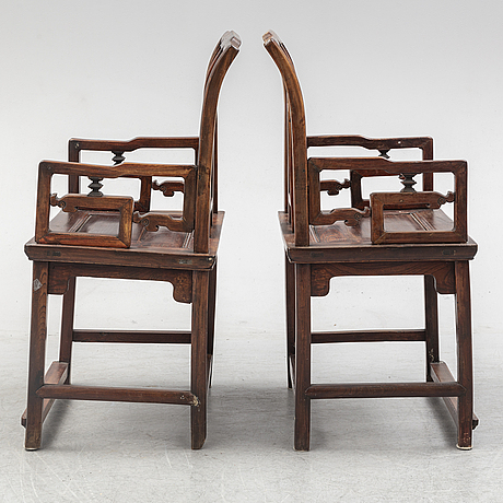 A pair of chinese hardwood armchairs, early 20th century.