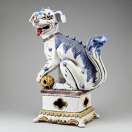 A large chinese ceramic tile sculpture of a buddhist lion, 20th century.