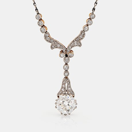 A necklace in 18k gold and platinum with an old-cut diamond ca 1.00 ct quality ca h vs.