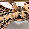 A 14k gold brooch set with old-cut diamonds.