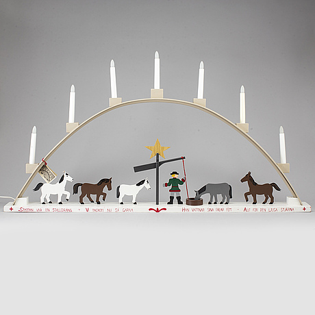 An swedish 21st century advent electric lamp with seven bulbs.