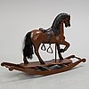 A painted rocking horse from around 1900.