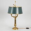 An empire style brass table lamp, second half of the 20th century.