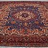 A carpet, kashmar, signed, ca 383 x 303 cm.
