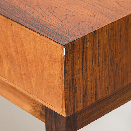 A side table and mirror in rosewood by g&t hovmantorp, sweden.