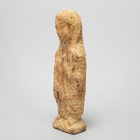 A sculpture, possibly medieval.